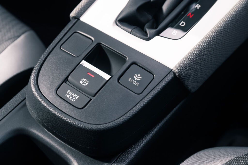 A closeup view of the gear selector in the car