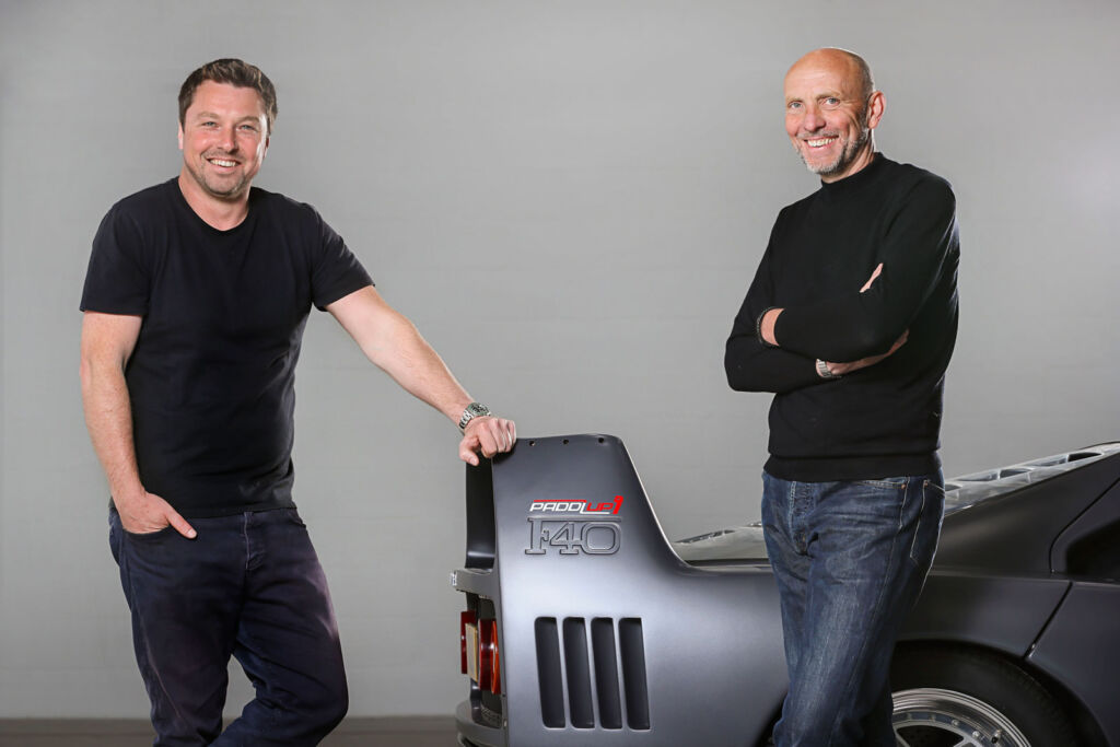 The founders of the auction platform with a Ferrari F40
