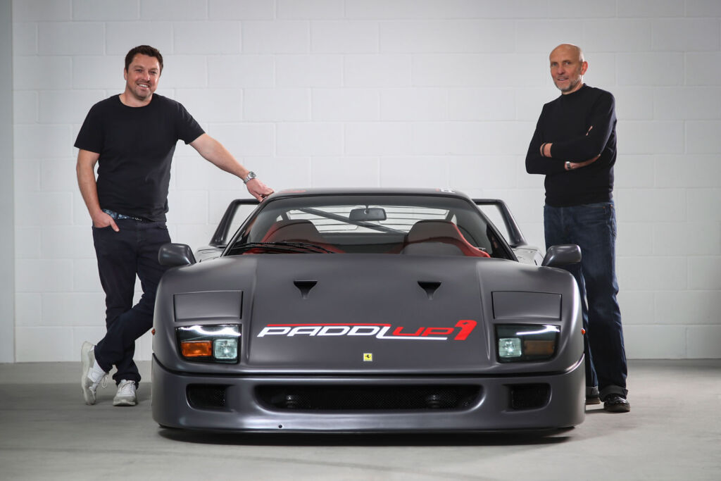 The founders standing either side of their grey wrapped Ferrari F40
