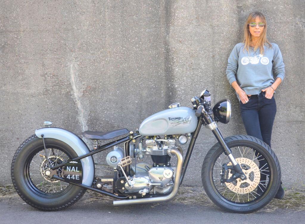 Lyn Jackson next to a Triumph Bobber motorbike
