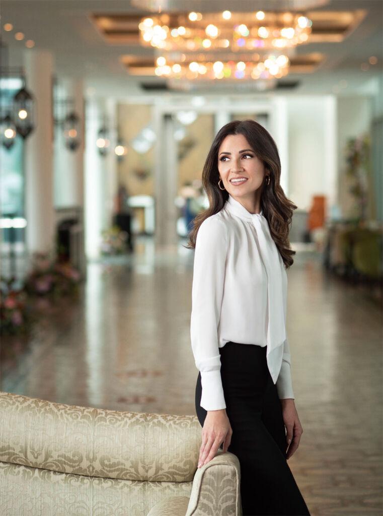 Martha Waslen checking into a hotel