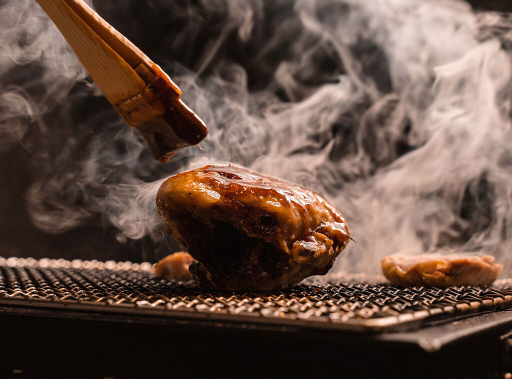 Meat using traditional African cooking over a fire