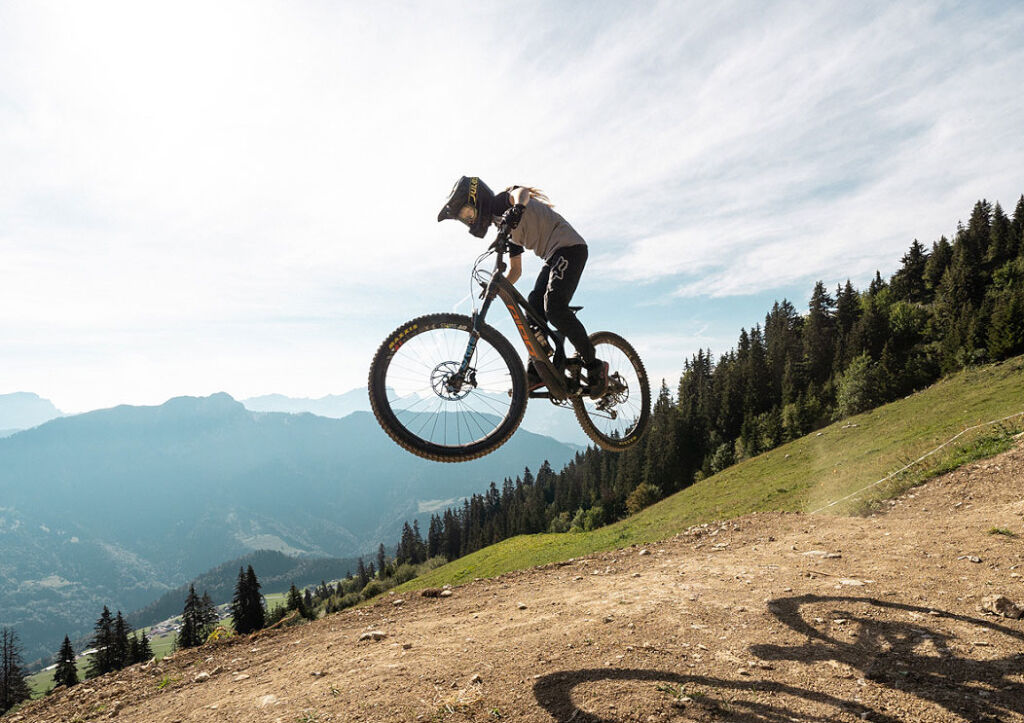 A mountain biker taking to the air on one of the cycling tracks