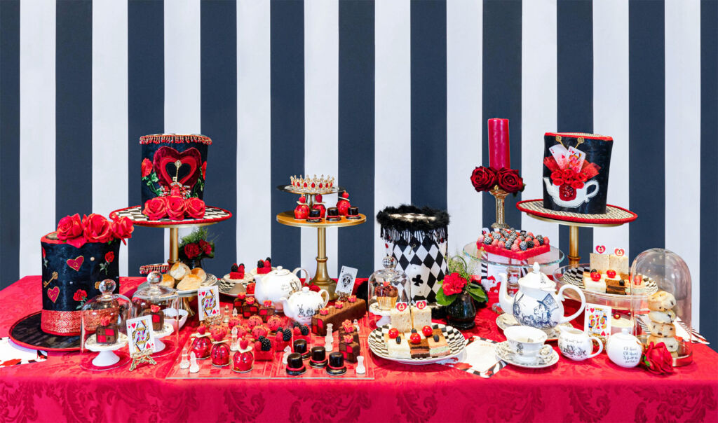 A table jam-packed with delicious themed offerings at the Queen of Hearts Afternoon Tea