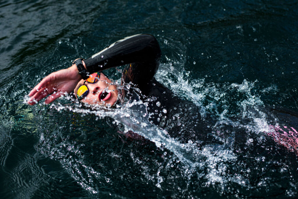 A female open water swimmer in competition