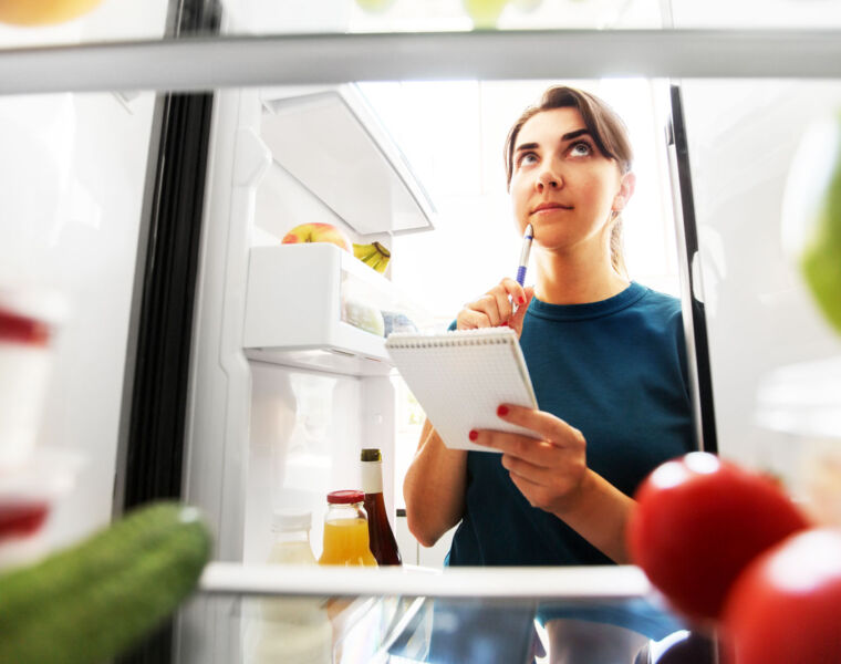 A woman being smart with her food shopping and not buying foods that will go rotten sooner than expected