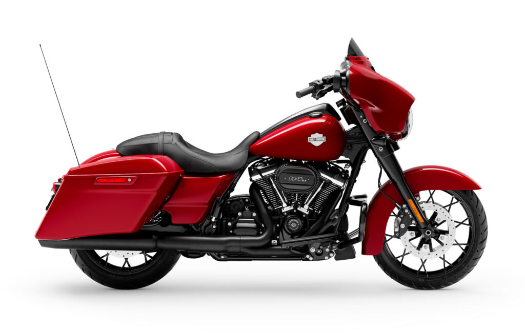 A side profile of a red coloured version of the motorcycle