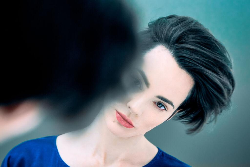 Sofya Skya gazing at her reflection in a mirror
