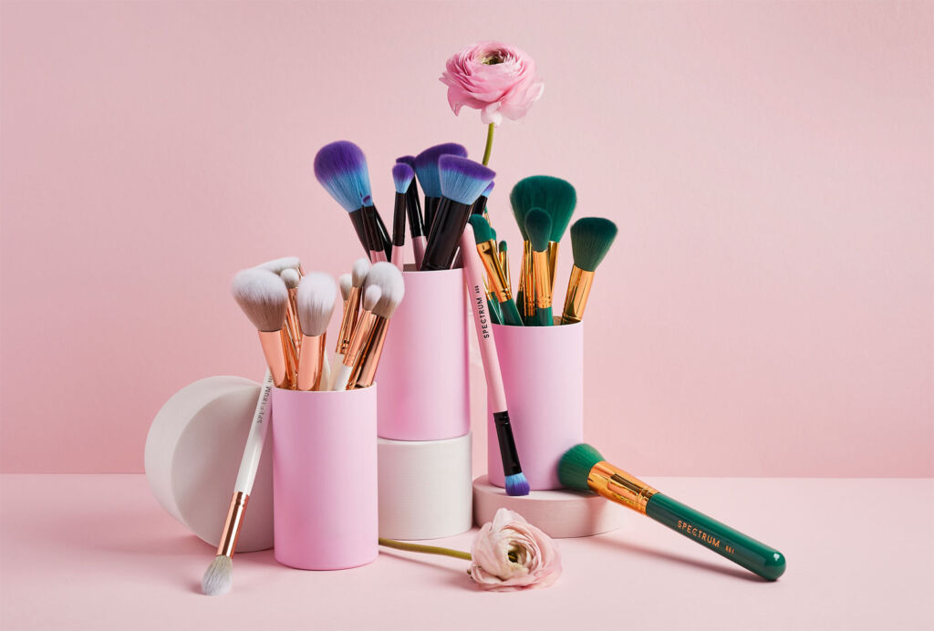 Spectrum make-up brushes sitting in pink pots