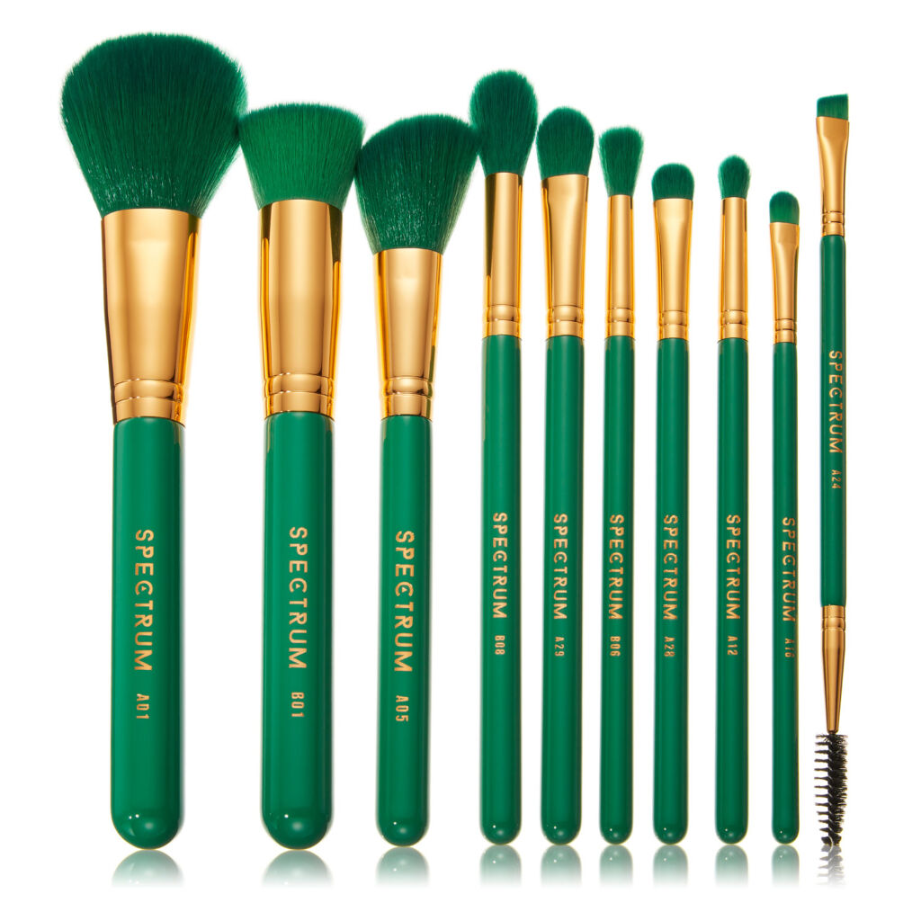 A range of make up brushes in green colour