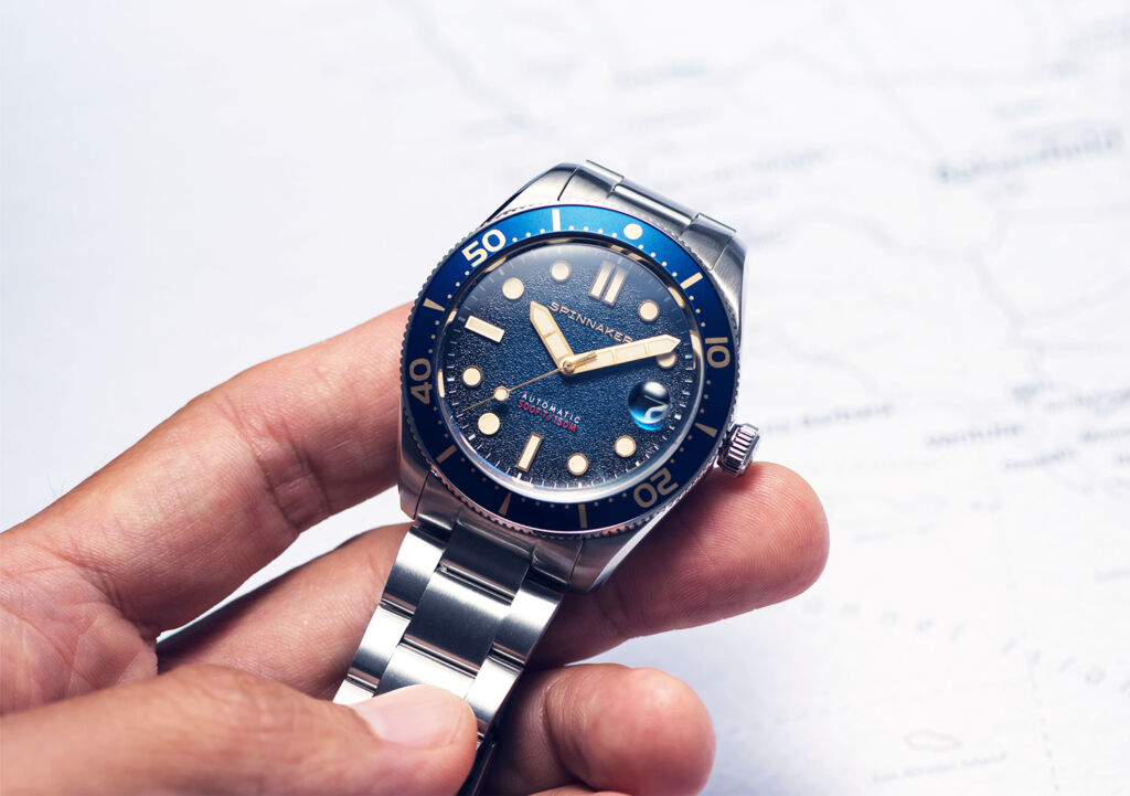 The timepiece being held in the hand