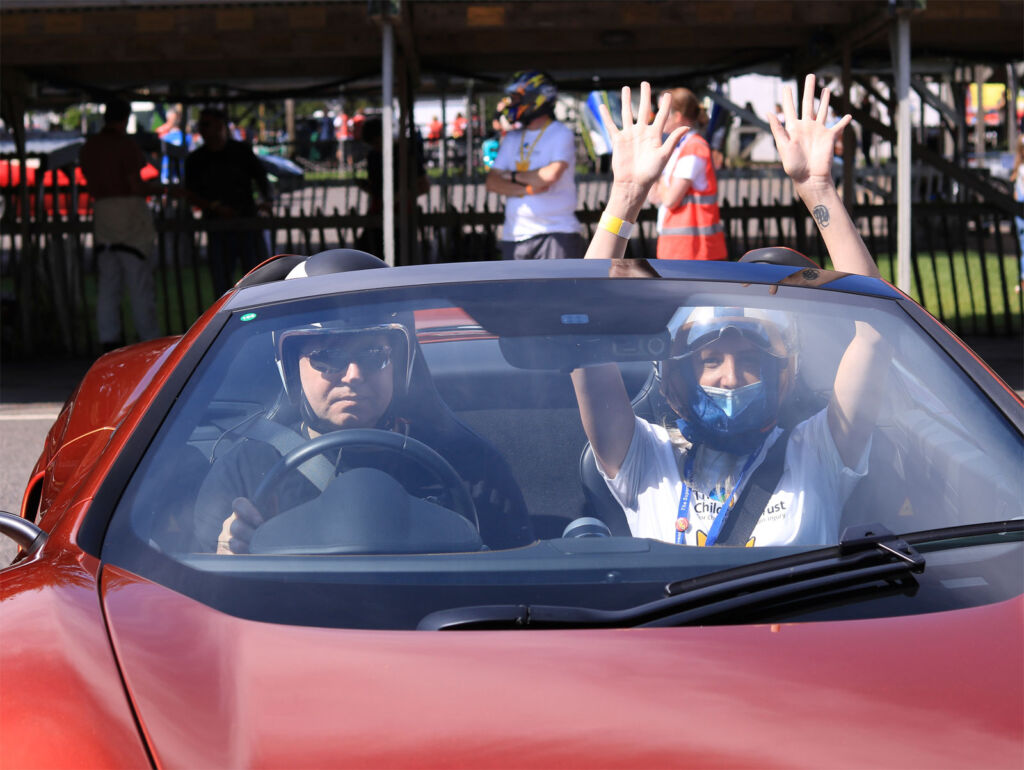 A young person having fun in a supercar