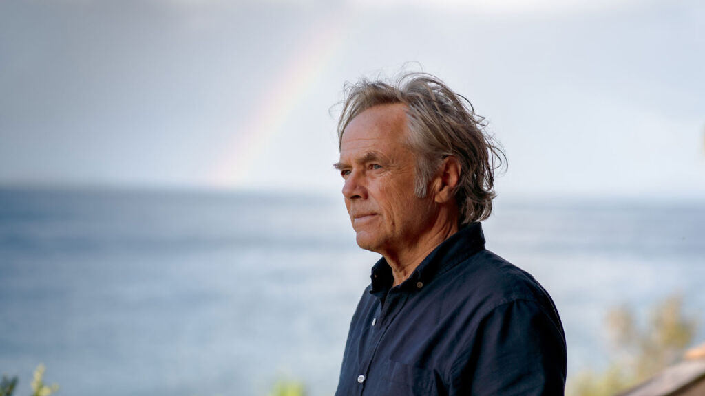 David Carson in thought whilst gazing over the sea