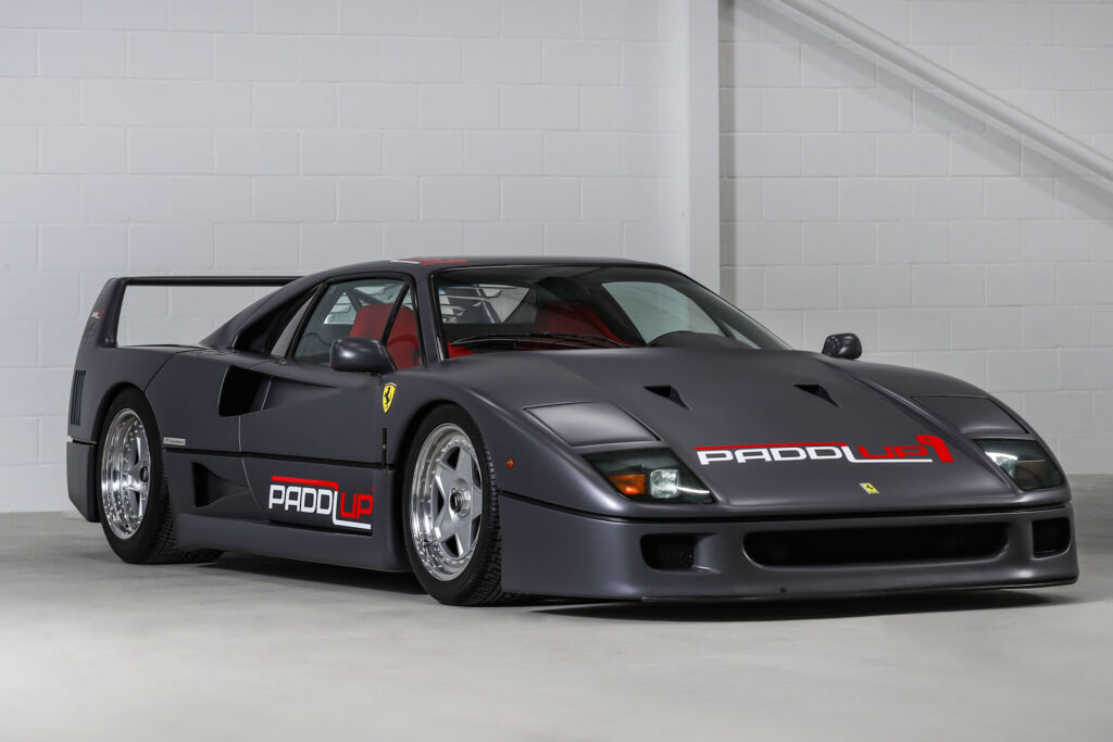 A grey wrapped Ferrari F50 supercar with colourful livery