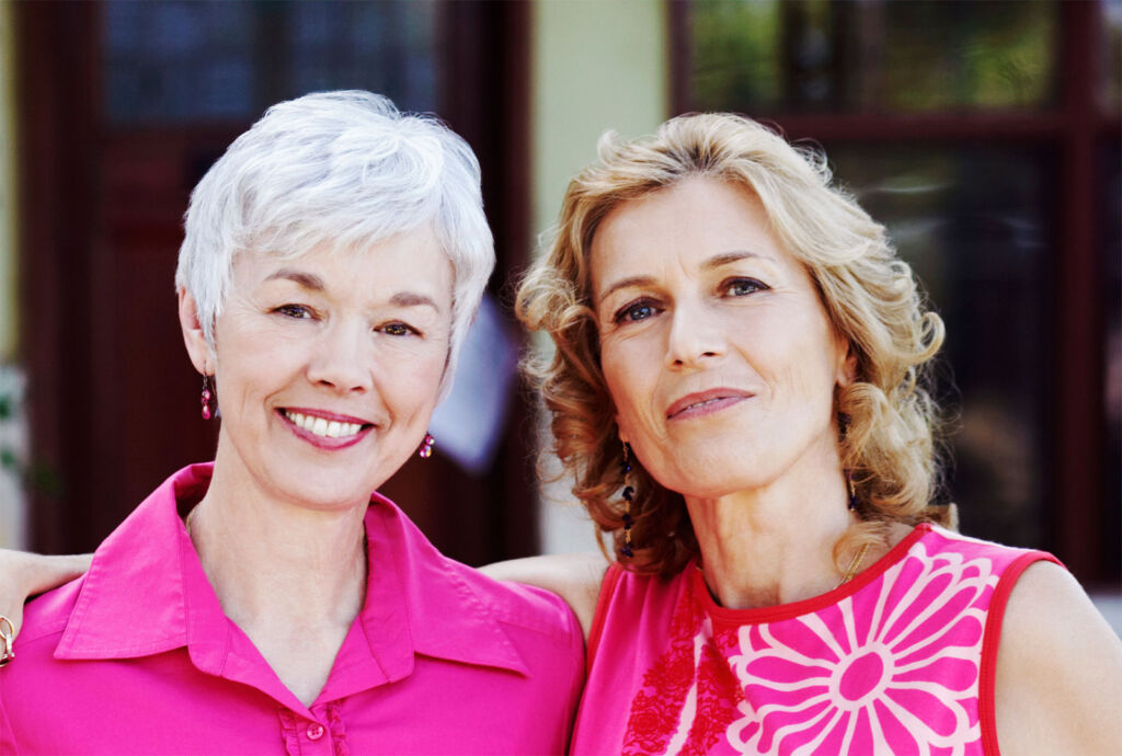Two older women without sagging skin and wrinkles