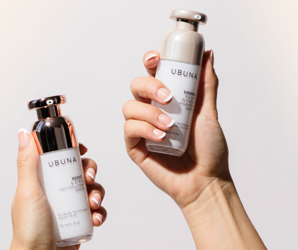 Two of the beauty products being held in each hand