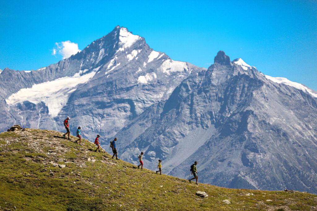 People walking adjacent to Mount Fallere. Photo by Enrico Romanzi
