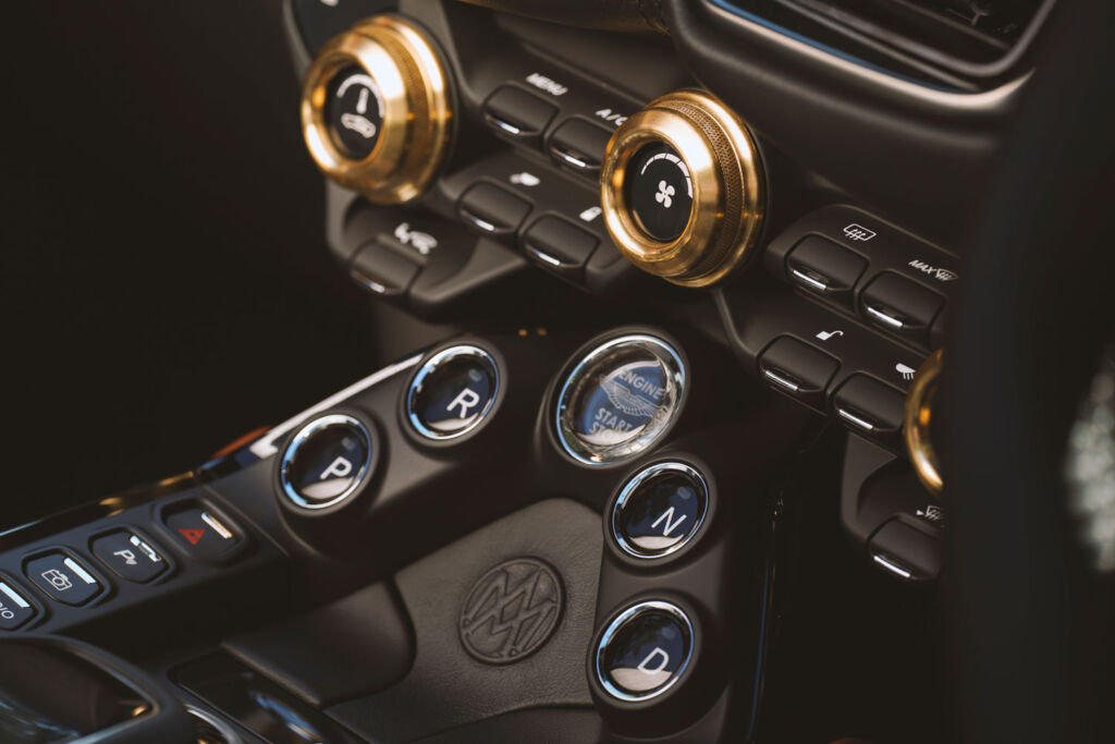 A closeup view of the brass dials on the new roadster