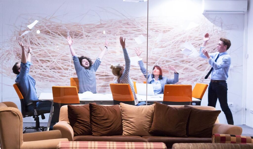 A group of people celebrating in the office