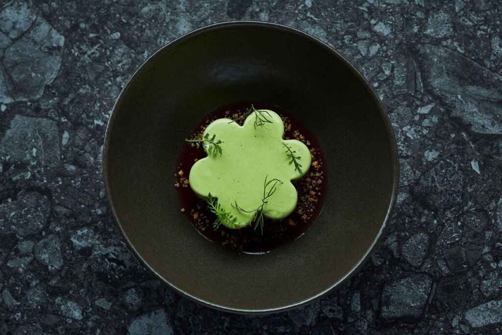 A bowl containing some dill flavoured ice cream