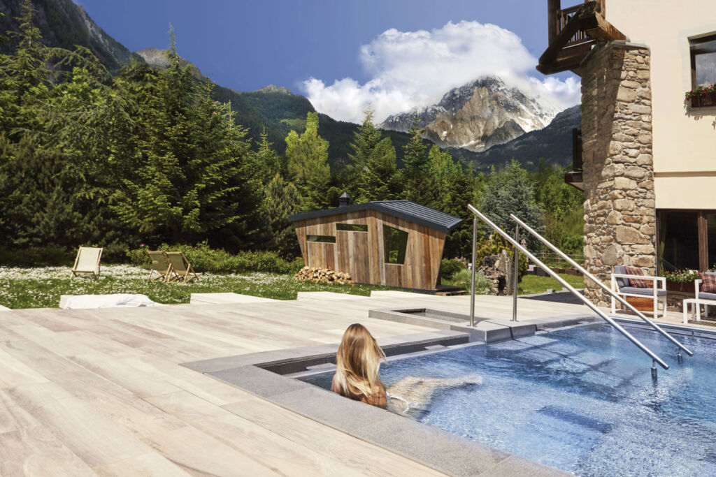 A guest enjoying one of the luxurious spa pools in the Aosta Valley