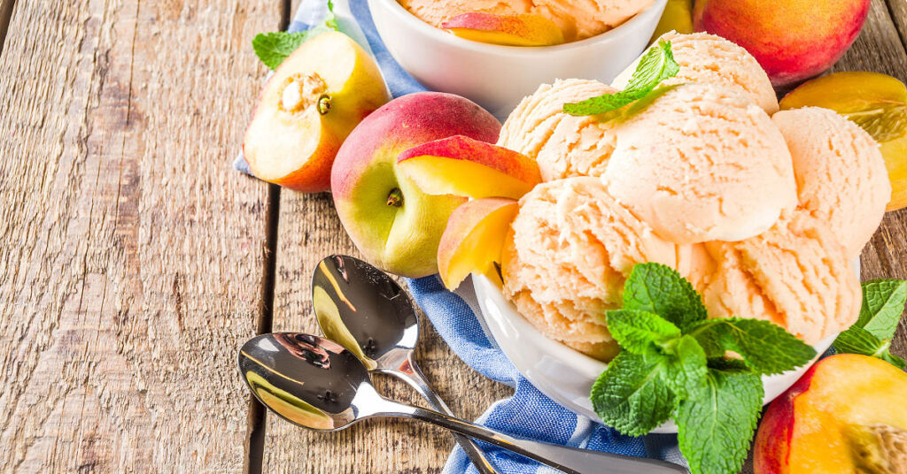 A colourful bowl of ice cream stacked with fresh fruit