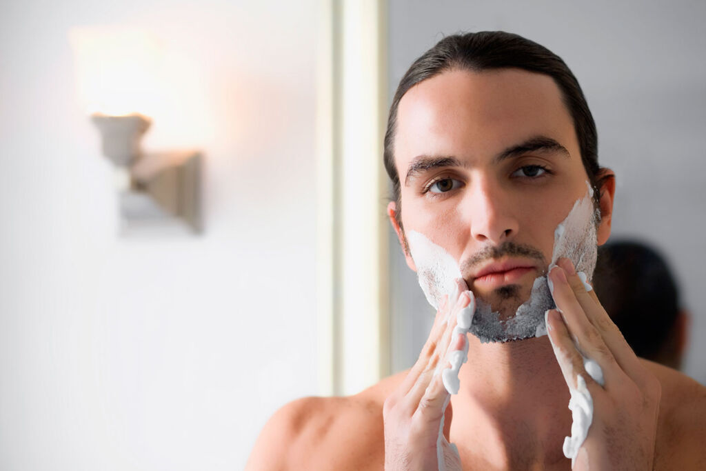 A young man preparing his skin for a wet shave