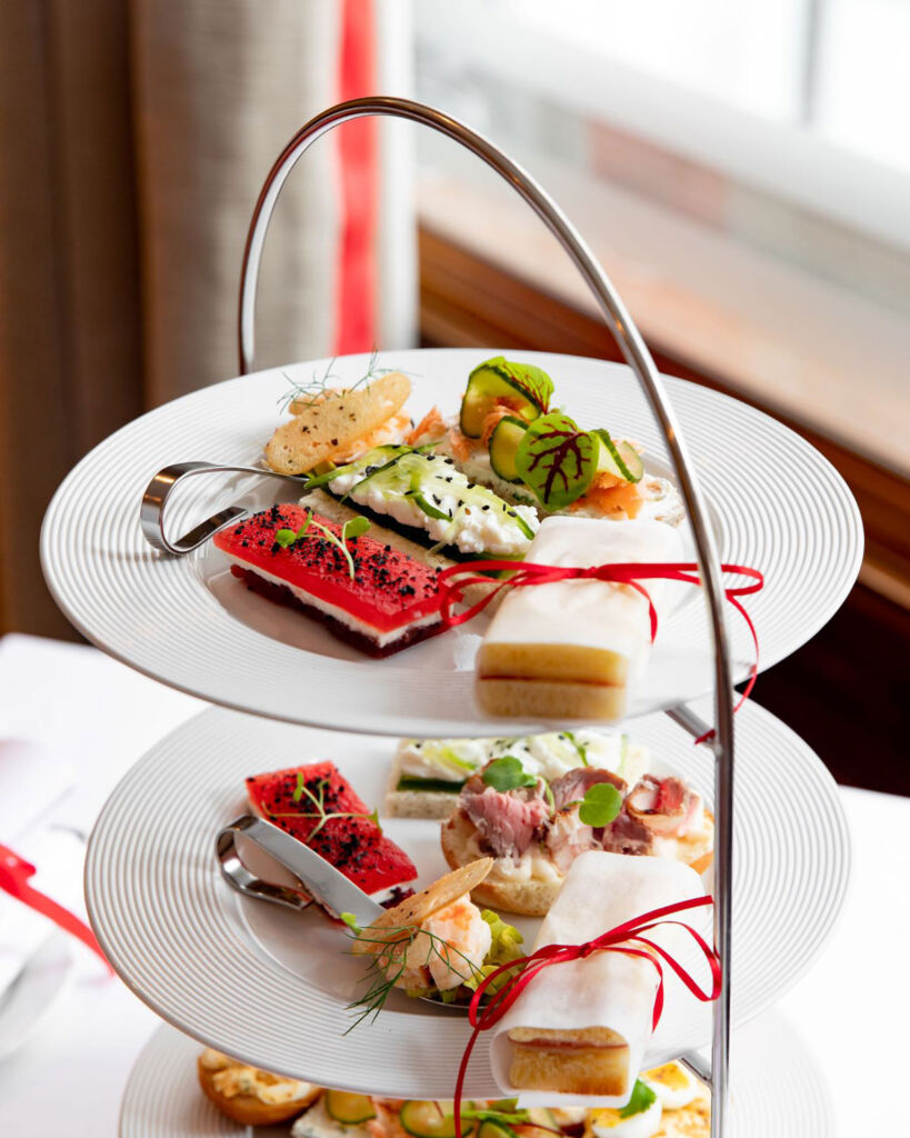 The Afternoon tea laid out on a silver three tiered tray