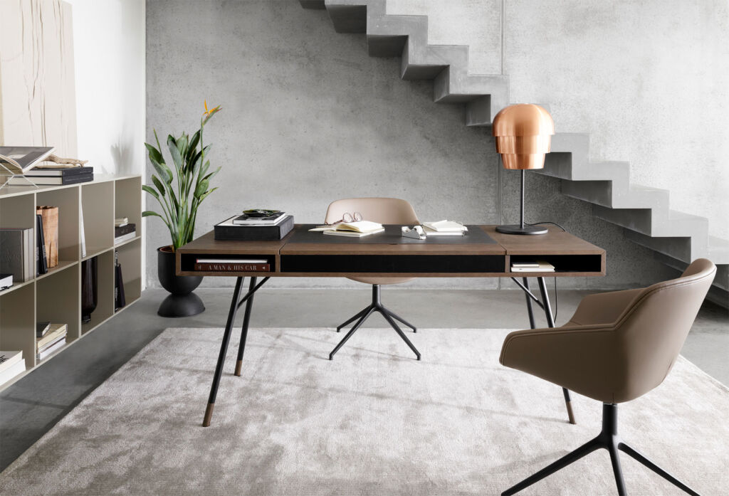 The BoConcept Cupertino desk by the stairs in a hallway