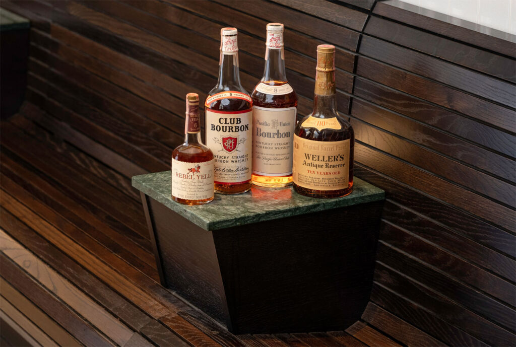 Bottles of Stitzel Weller Club Bourbon Rebel Yell and Antique reserve whiskey