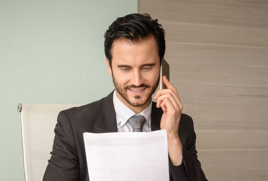 A man checking a contract with a company over the phone