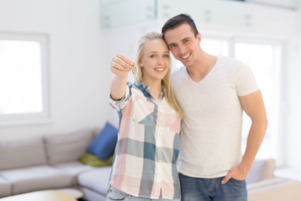 A happy couple with the keys to their new home