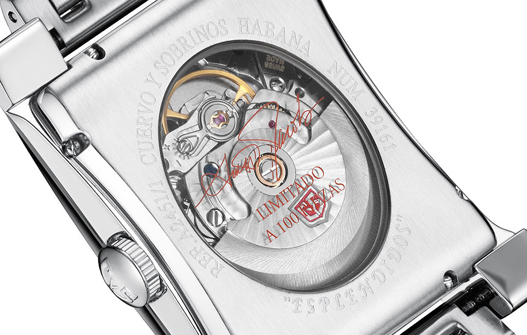A closeup view of the watch movement through the clear oval lens on the rear of the case