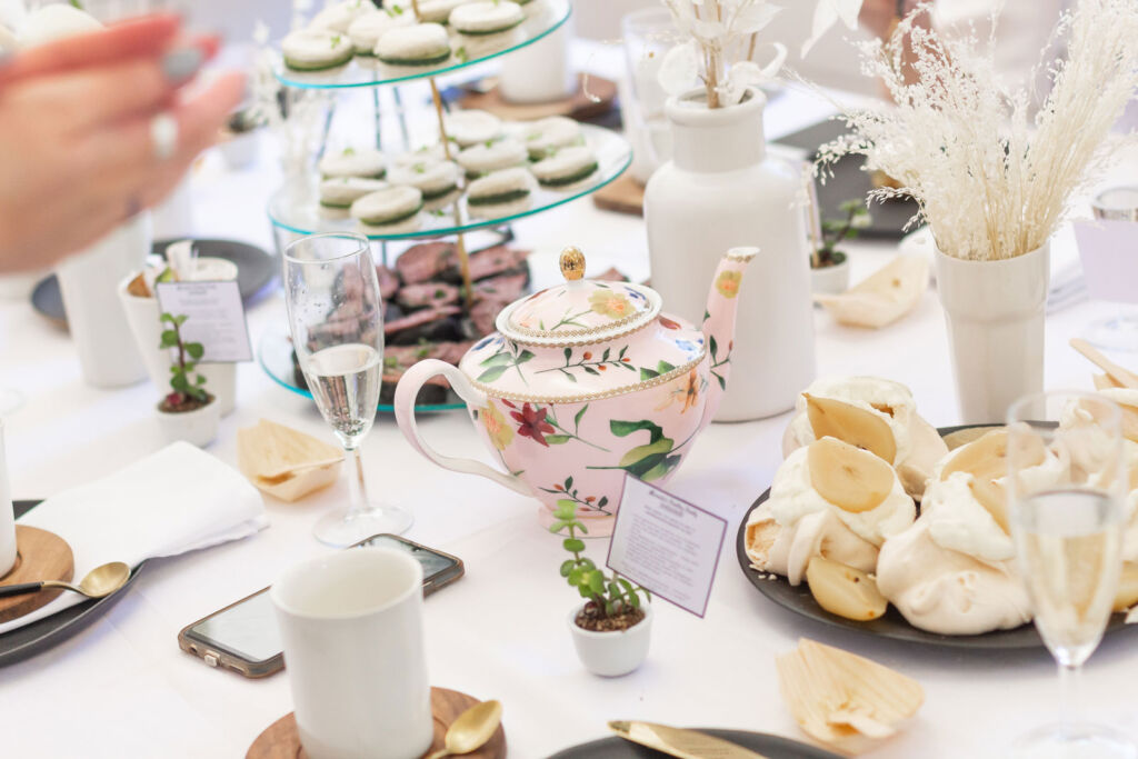 A magnificent afternoon tea laid out on a white tablecloth