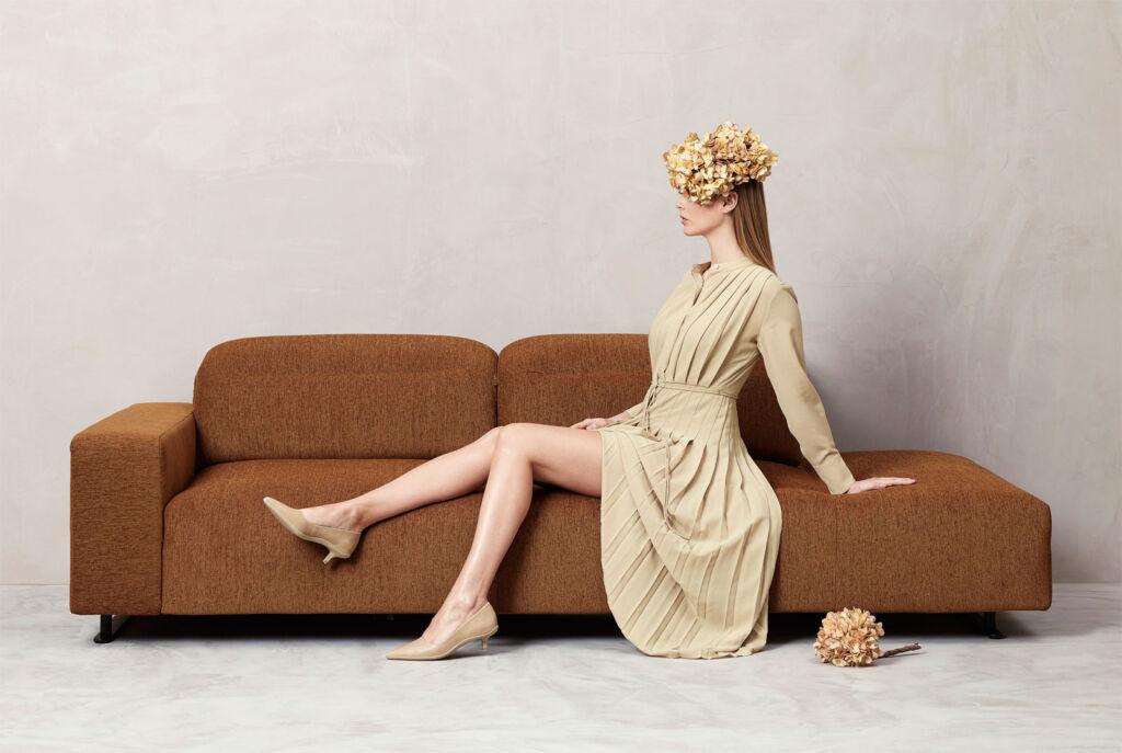 Female model sat on a BoConcept sofa