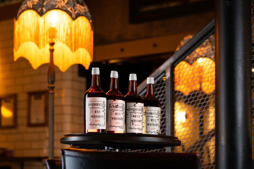 Four bottles of Overholt Rye Whiskey 1908