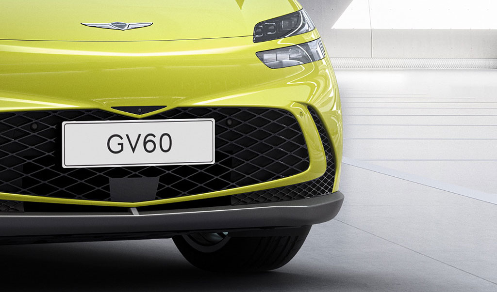 A close up of the cars grille and badge