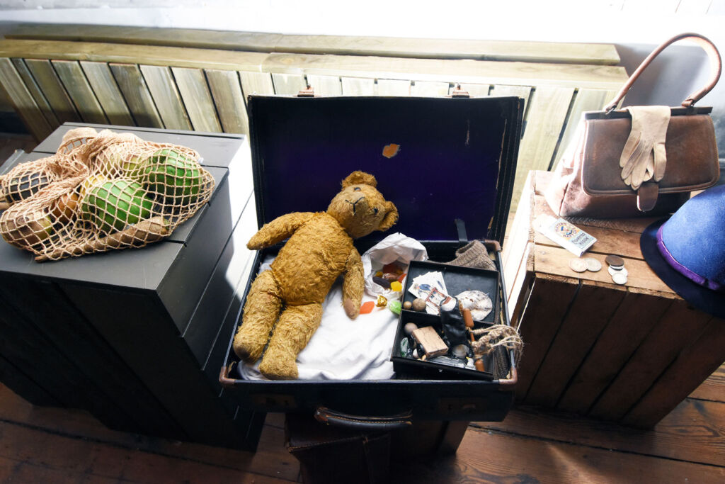 Many historic items have been sourced to dress the house including this box containing vintage toys for children