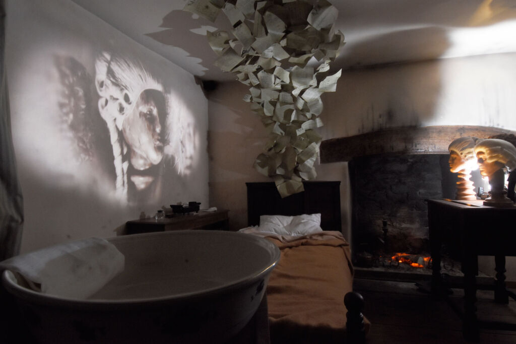 A look inside one of the bedrooms with its wash bowl and rather spooky decorations