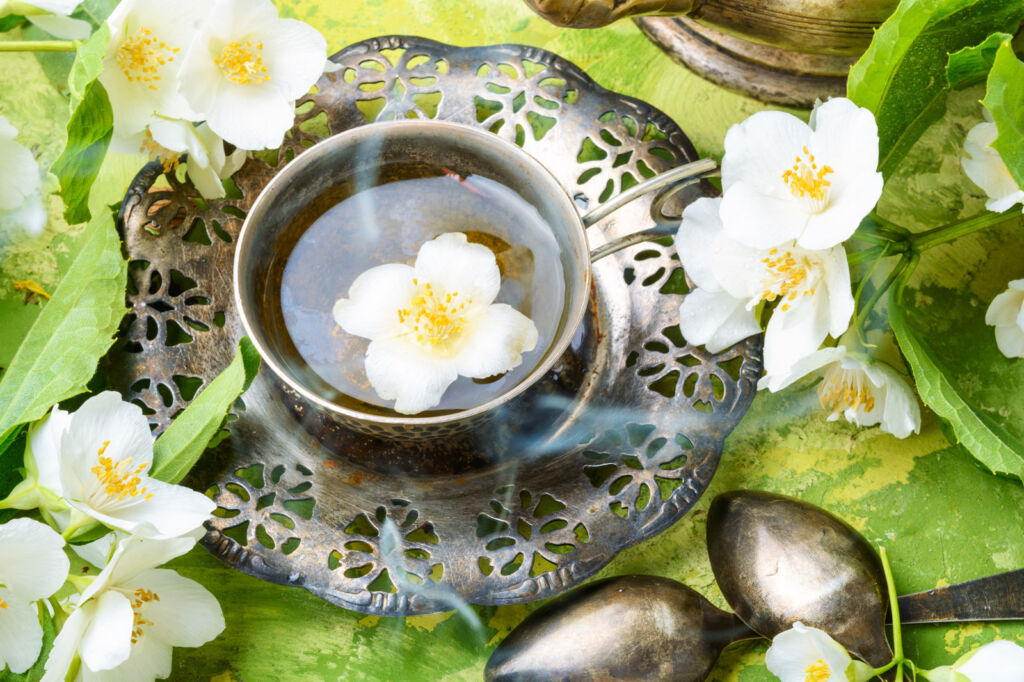 Jasmine flowers with a freshly made cup of Jasmine tea