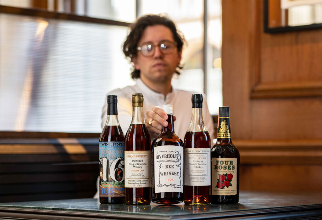 Joe Wilson, Head of Content at Whisky Auctioneer examining some of the rare bottles