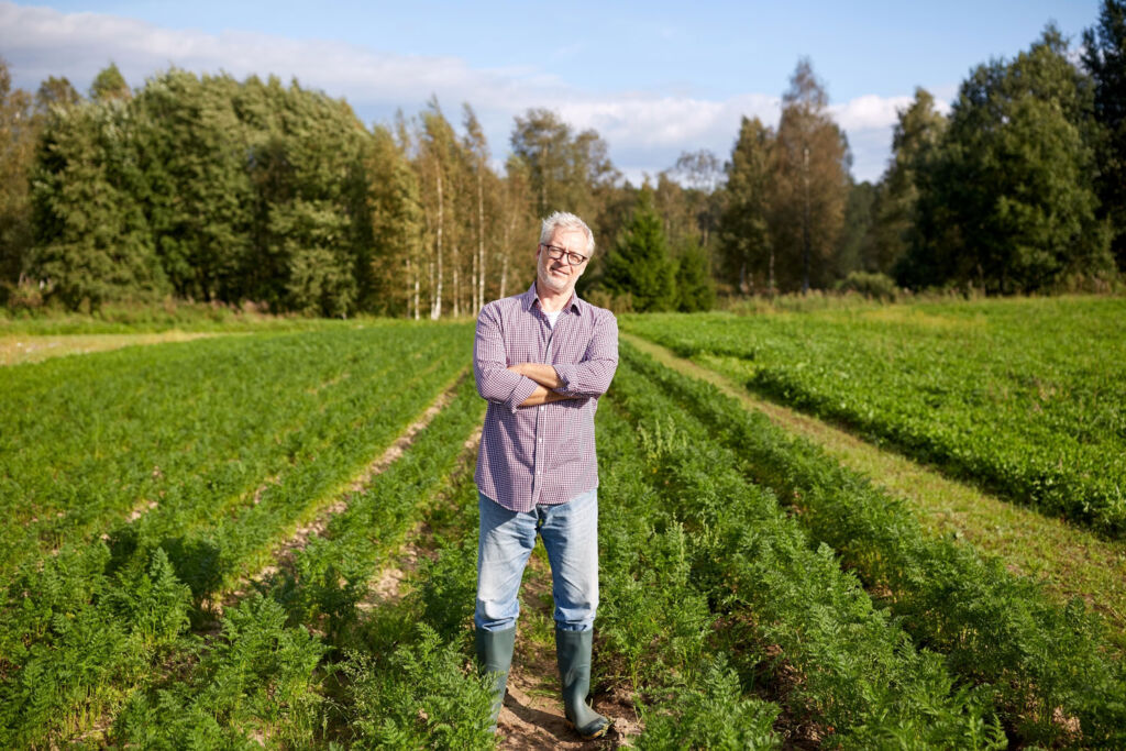 A man standing in an agricultural field angry that it might be turned into a modern housing estate