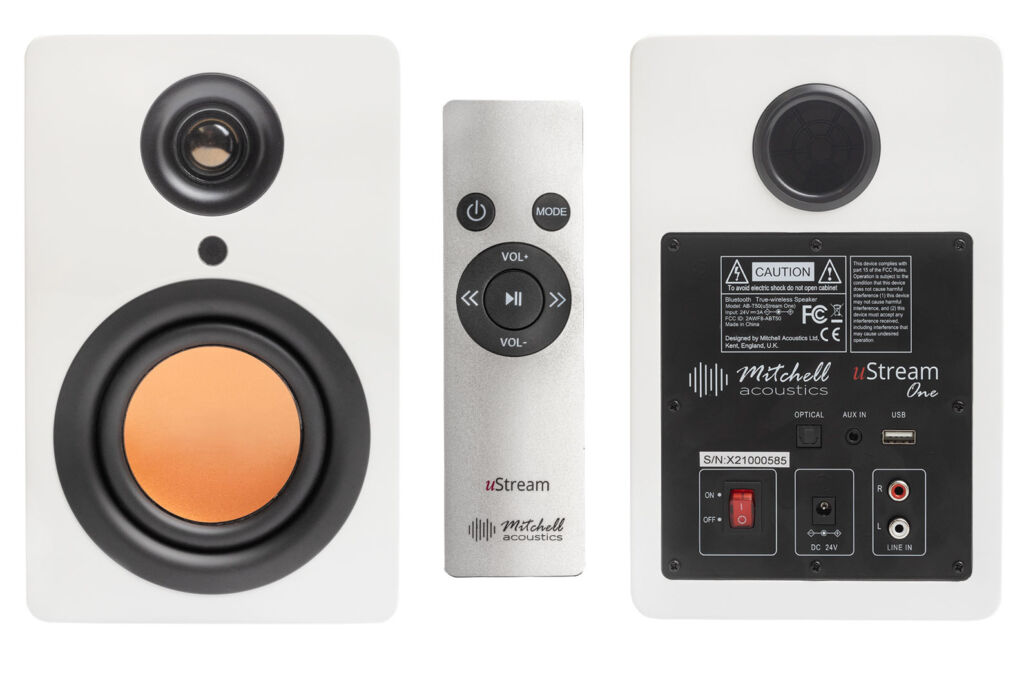 The front of the speakers with the remote control and the rear showing the input options