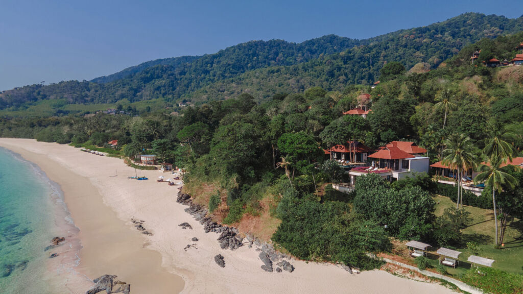 A view of one of the resorts villas next to the sandy shore