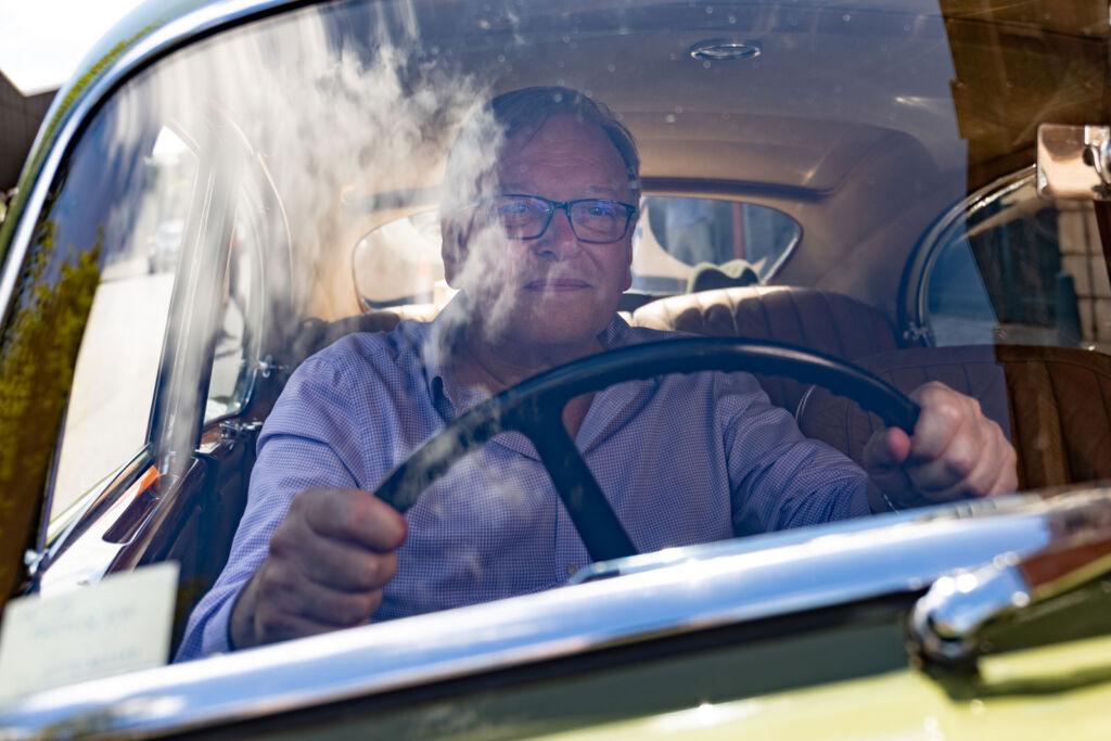 Simon Topman behind the wheel of the 1954 Bentley