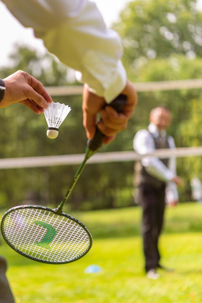 Gentlemen enjoying a game of badminton