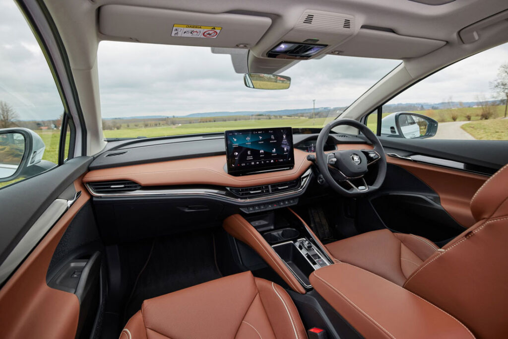 An image showing the high-quality brown leather interior in the Skoda Enyaq iV 60