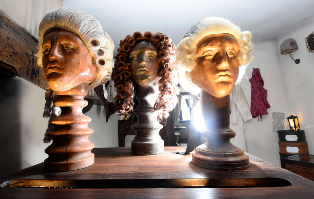 Three mannequin heads displaying the most fashionable wigs of the day