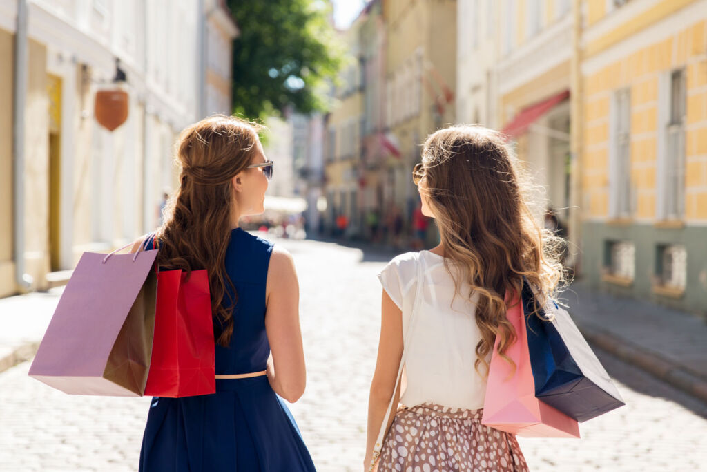Two young ladies out shopping on a cobbled street