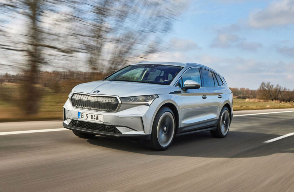 A silver version of the Skoda Enyaq iV 60 being driven on the open road